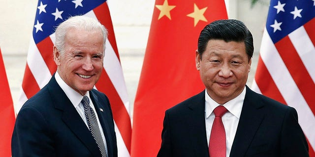 Chinese President Xi Jinping shakes hands with U.S. Vice President Joe Biden (L) inside the Great Hall of the People in Beijing December 4, 2013. REUTERS/Lintao Zhang/Pool (CHINA - Tags: POLITICS) - GM1E9C41JRZ01