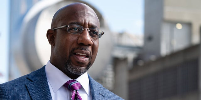 Democratic U.S. senatorial candidate Raphael Warnock speaks to the media after casting his ballot at State Farm Arena on October 21, 2020 in Atlanta, Georgia. Warnock is in a runoff against incumbent Kelly Loeffler set for Jan. 5. (Photo by Elijah Nouvelage/Getty Images)