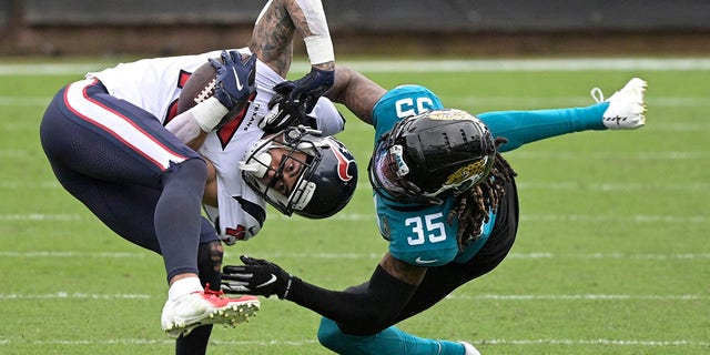 Houston Texans wide receiver Will Fuller V, left, is tackled by Jacksonville Jaguars cornerback Luq Barcoo (36) after a reception during the second half of an NFL football game, Sunday, Nov. 8, 2020, in Jacksonville, Fla. (AP Photo/Phelan M. Ebenhack)