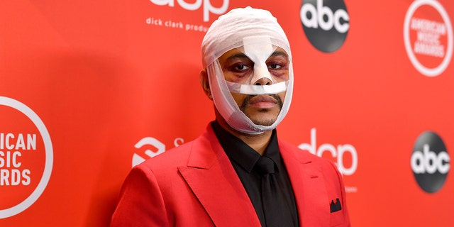 The Weeknd appeared at the 2020 AMAs with a bloodied and bandaged face.