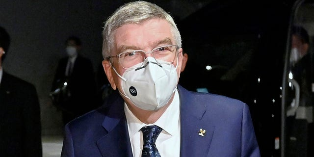 International Olympic Committee President Thomas Bach arrives at a hotel in Tokyo Sunday, Nov. 15, 2020. IOC President Bach is beginning a visit to Tokyo to convince politicians and the Japanese public that the postponed Olympics will open in just over eight months.(Kyodo News via AP)