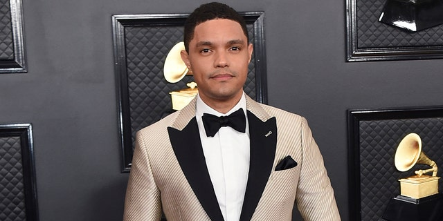 Trevor Noah arrives at the 62nd annual Grammy Awards in Los Angeles on Jan. 26, 2020. Noah has been tapped to host the 2021 Grammy Awards. The Recording Academy made the announcement hours before the nominees for the 2021 show would be revealed. It would mark Noah's first time hosting the Grammys.