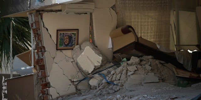 The interior of a destroyed living room of a family flat is seen after the building collapsed in Izmir, Turkey, Sunday, Nov. 1, 2020.