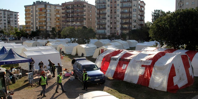 Local residents stay outdoors for fear of strong aftershocks after an earthquake collapsed their houses, in Izmir, Turkey, Sunday, Nov. 1, 2020. The strong earthquake in the Aegean Sea struck Turkey and Greece on Friday.