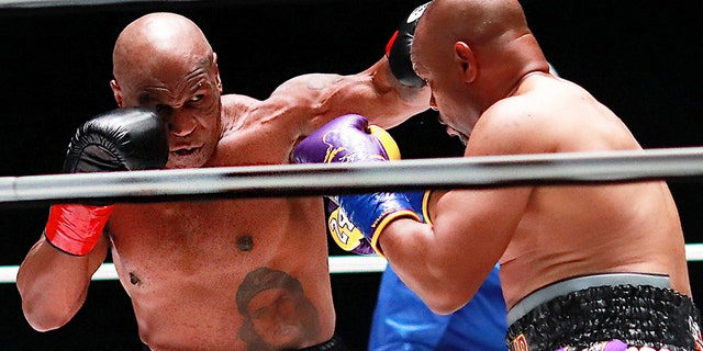 In a photo provided by Triller, Mike Tyson throws a punch during the third round against Roy Jones Jr. in an exhibition boxing bout Saturday, Nov.. 28, 2020, in Los Angeles. (Associated Press)
