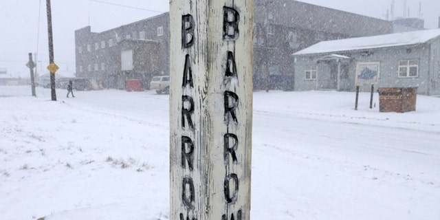 In this Oct. 10, 2014, file photo, snow falls around a sign in Barrow, Alaska. Residents in Barrow, the nation's northernmost community, have voted to change the name of their city back to its traditional Inupiaq name of Utqiagvik.