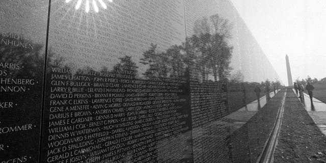 The morning sun reflects from the black marble walls of the Vietnam Veterans Memorial in Washington on Nov. 9, 1982. The memorial contains the names of more than 50,000 Americans killed or missing in the Vietnam conflict. (AP Photo/Bob Daugherty)