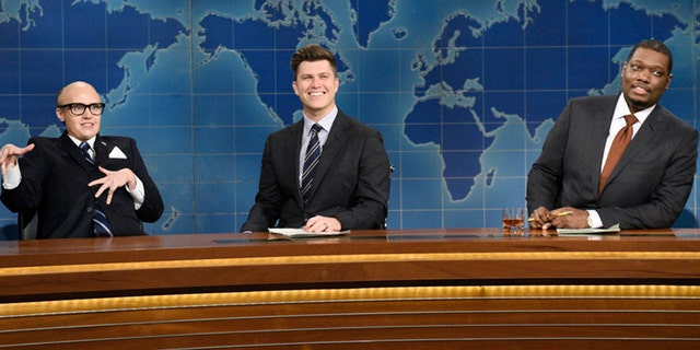 Kate McKinnon as Rudy Giuliani, anchor Colin Jost, and anchor Michael Che during Weekend Update on Saturday, November 7, 2020.