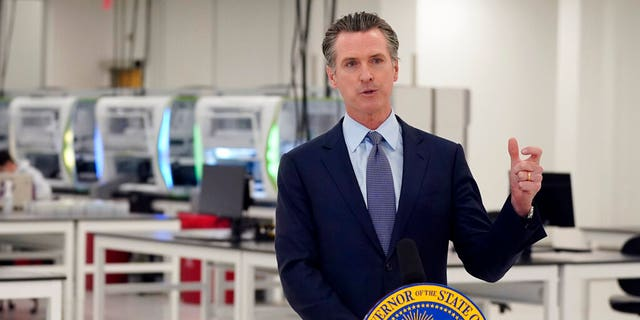 FILE: California Gov. Gavin Newsom speaks at a COVID-19 testing facility in Valencia, Calif. Newsom on Monday, Nov. 16, 2020,