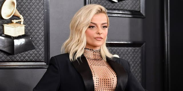 Bebe Rexha showed some skin when she announced that she'd voted.