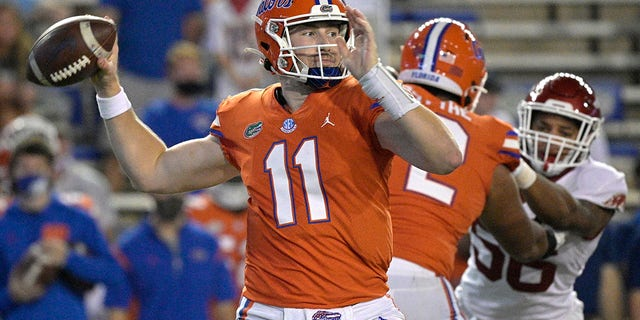 Florida quarterback Kyle Trask (11) looks to throw a pass during the first half of an NCAA college football game against Arkansas, Saturday, Nov. 14, 2020, in Gainesville, Fla. (AP Photo/Phelan M. Ebenhack)