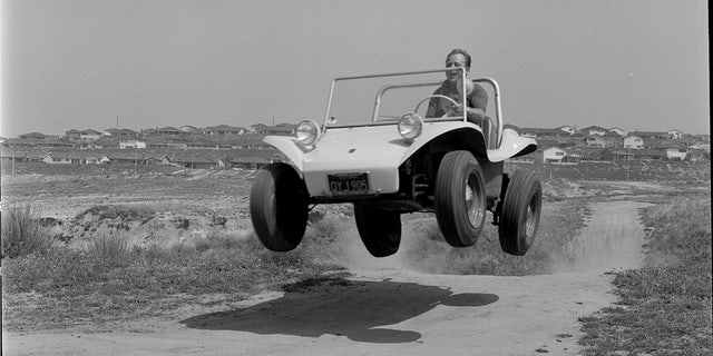 Manx testing one of his dune buggies in the 1960s.