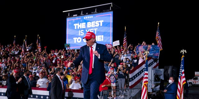 President Donald Trump dances as he walks off stage after speaking during a campaign rally at Miami-Opa-locka Executive Airport, Monday, Nov. 2, 2020, in Opa-locka, Fla. (AP Photo/Evan Vucci)