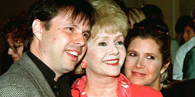 Debbie Reynolds (C), with son Todd Fisher and daughter Carrie Fisher.