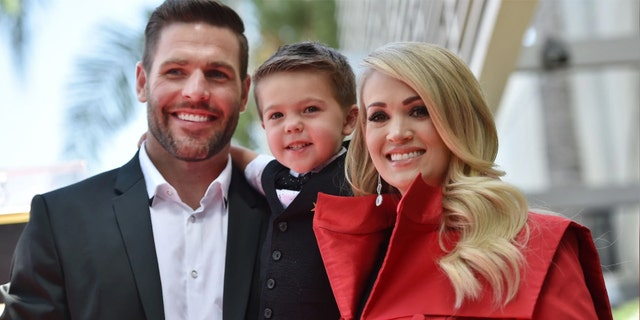 Carrie Underwood, husband Mike Fisher and their son Isaiah at Underwood's star unveiling ceremony on the Hollywood Walk of Fame on September 20, 2018.