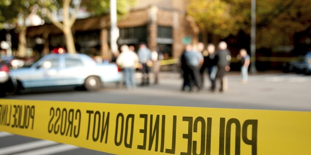 Police tape cordons off a crime scene.