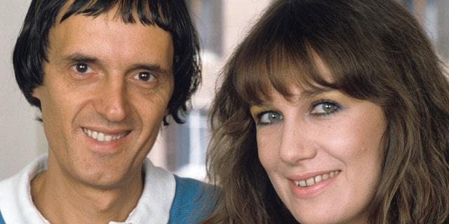 Italian director and scriptwriter Dario Argento and his wife, the Italian actress Daria Nicolodi smiling and posing in 1984.