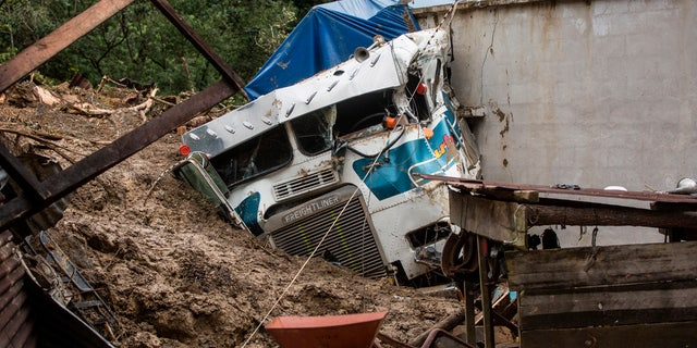 Part of her was buried in a massive rain-induced landslide in the village of Queja, in Guatemala, Saturday, November 7, 2020, as a result of Tropical Storm Eta.