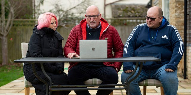 Family adviser Radd Seiger, center, sits with Charlotte Charles and Tim Dunn, parents of 19-year-old Harry Dunn, at their home in Charlton, England, on Tuesday. (Jacob King/PA via AP)