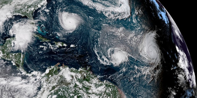 This enhanced satellite image made available by NOAA shows Tropical Storm Florence, upper left, in the Atlantic Ocean on Tuesday, 씨족. 11, 2018 ...에서 3:30 오후. EDT. At center is Tropical Storm Isaac and at right is Hurricane Helene.