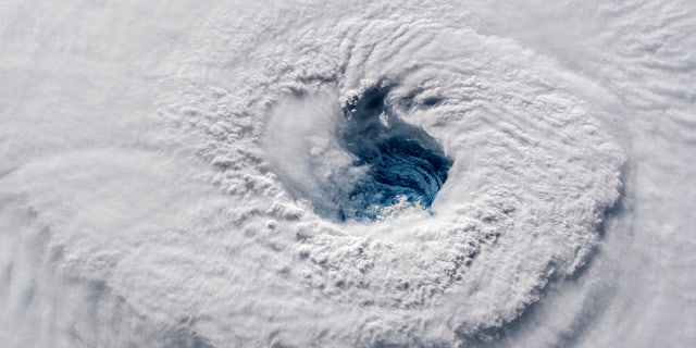 In this Sept. 12, 2018 photo provided by NASA, Hurricane Florence churns over the Atlantic Ocean heading for the U.S.