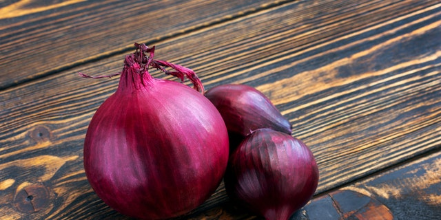 "A TikTok user has gone viral after he posted a video of himself eating a raw onion for the ""COVID Taste Test"" trend. (iStock)"