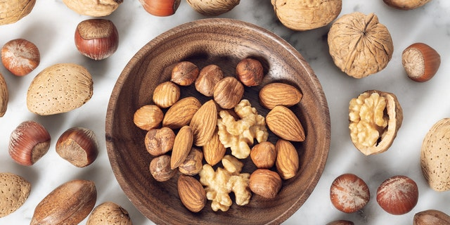 "The ""nut group"" incorporated almonds, hazelnuts and walnuts into their diets for 14 weeks."