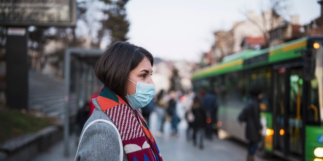 Those flouting masks over previous coronavirus infection and assumed immunity can still carry the virus and transmit it to others, doctors say. (iStock)