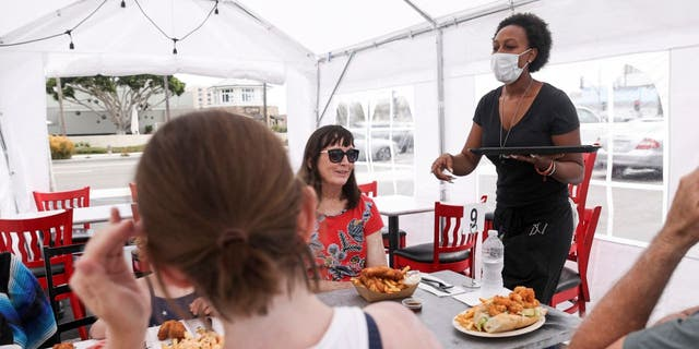 For diners who do opt to eat out, the CDC recommends wearing masks as much as possible, social distancing and washing hands when entering and exiting the restaurant.
