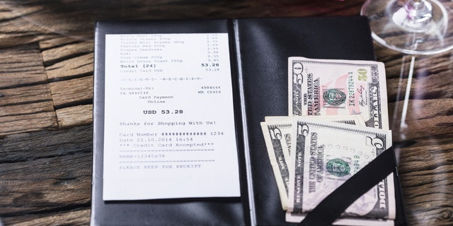 A restaurant in Franklin, Tennessee, has to pay $179,878 to 40 employees because it kept servers' and hosts' tips. (iStock)