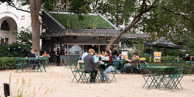 File photo - people dine outside Shake Shack in Madison Square Park in September. (Photo by Noam Galai/Getty Images)
