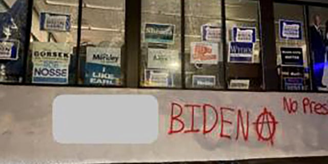 """A group spray-painted an anarchy symbol and messages like """"F--- Biden"""" and """"no presidents"""" on the Multnomah County Democrats campaign office in Portland Sunday. (Portland Police Bureau)"""