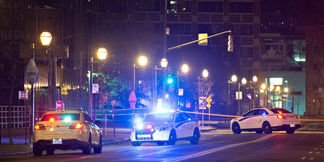Police cars block the Quai Saint-Andre sweet where they arrested a man in medieval disguise early Sunday, Nov. 1, 2020 in Quebec City, Canada.
