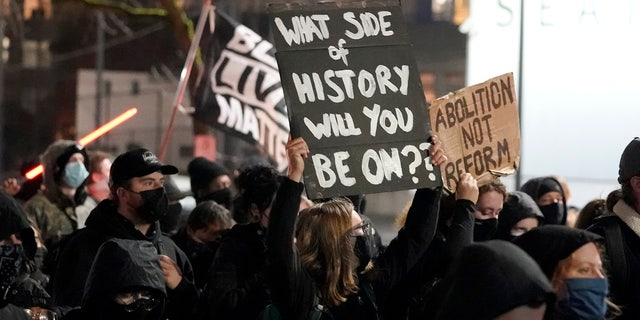 People march on the night of the election in Seattle, Tuesday, Nov. 3, 2020. (AP Photo/Ted S. Warren)