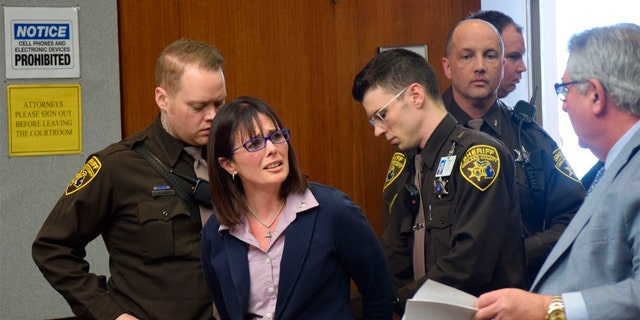 Tina Talbot gives her lawyer Jerome Sabbota a distressed look as Oakland County Sheriff's deputies put her in handcuffs after she is sentenced on April 4, 2019 in Oakland County Circuit Court. (Aileen Wingblad/The Daily Oakland Press via AP)