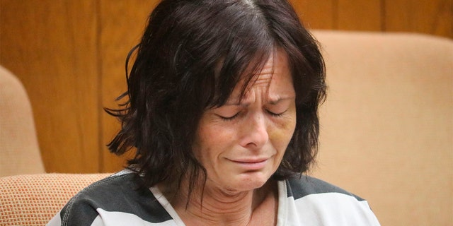 Tina Talbot sobs during a probable cause conference in Waterford Township's 51st District Court in late September 2018. (Aileen Wingblad/The Daily Oakland Press via AP)