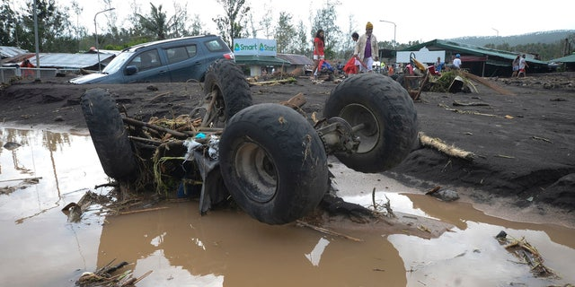 An All-Terrain Vehicle is toppled by strong winds and floods from Typhoon Goni as it hits Daraga, Albay province, central Philippines, Sunday, Nov. 1, 2020. AP Photo