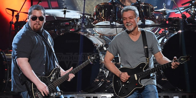 LAS VEGAS, NV - MAY 17: Bassist Wolfgang Van Halen (L) and guitarist Eddie Van Halen of Van Halen perform during the 2015 Billboard Music Awards at MGM Grand Garden Arena on May 17, 2015 in Las Vegas, Nevada.