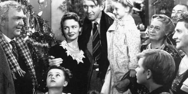 "Scene from Frank Capra's 1946 classic, ""It's a Wonderful Life,"" starring Donna Reed (L) and Jimmy Stewart (C)"