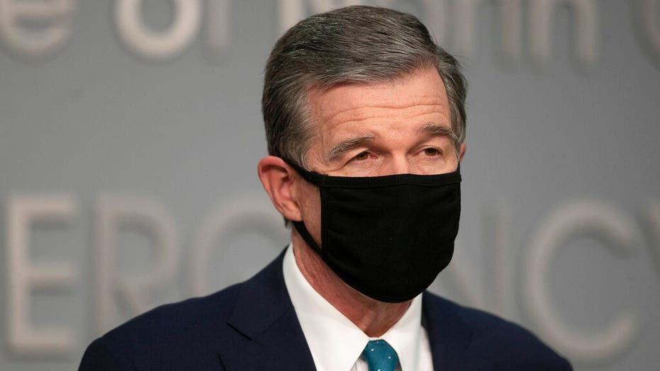North Carolina Democratic governor issues new coronavirus rule: Wear a mask at home if you have guests over