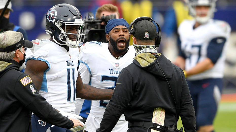 Ravens' John Harbaugh exchanges words with Titans' Malcolm Butler, Mike Vrabel after pregame midfield display