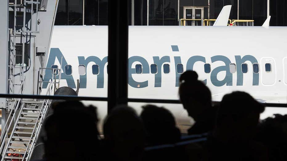 Passengers booted from American Airlines flight after 1 allegedly hides under other's 1st-class seat