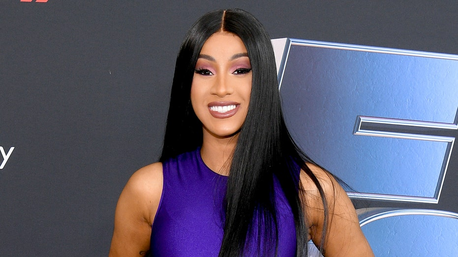 Cardi B smokes multiple cigarettes at once while watching watching 'these states turn red'