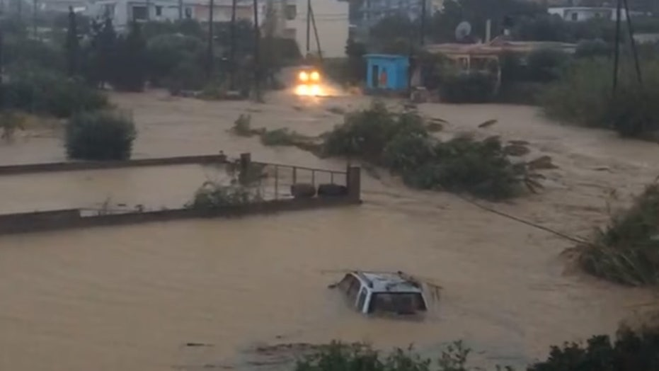 Flooding in Greece sweeps cars into sea, sends people to rooftops