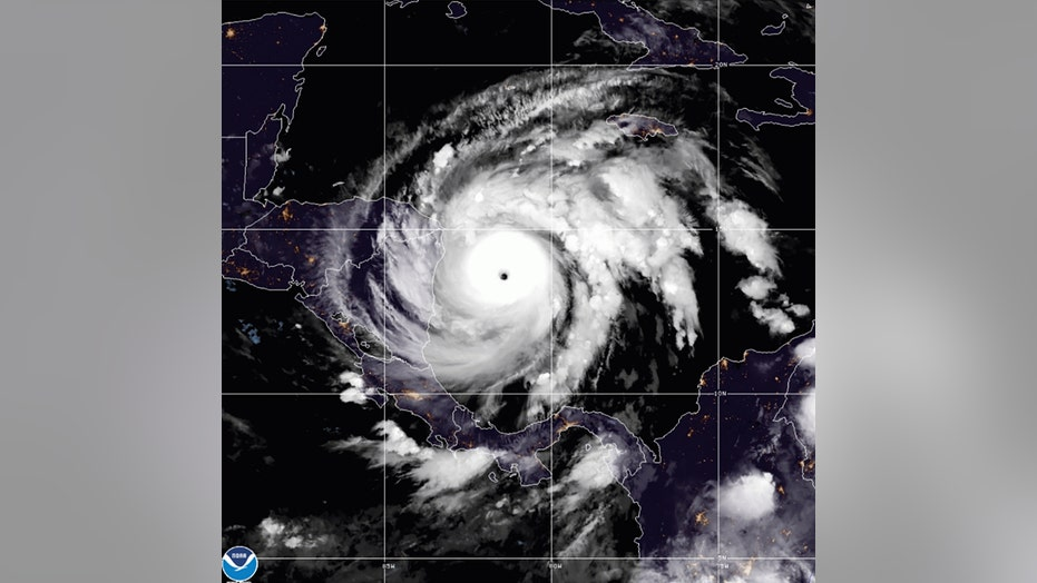 Hurricane Iota set for landfall, winter storms unsettle the West