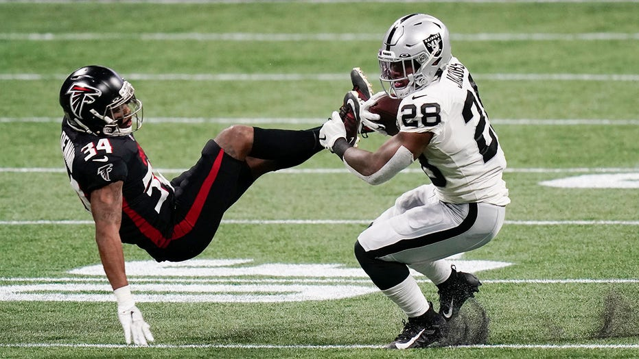Raiders' Josh Jacobs delivers huge hit on would-be Falcons tackler but is penalized