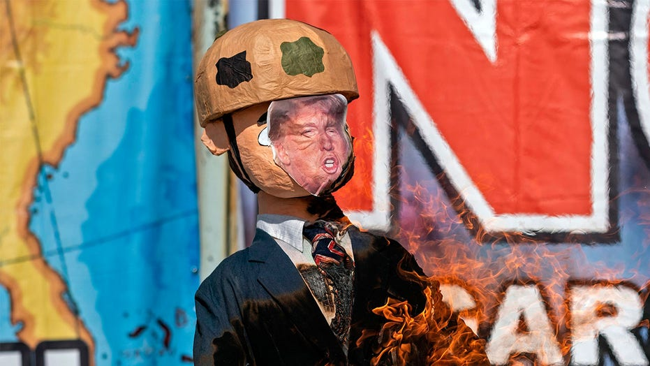 Protesters in Mexico burn Trump effigy at border, urge Americans to vote Biden