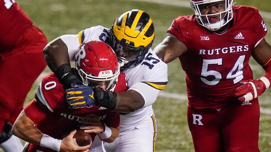 Jim Harbaugh, Michigan survive 3 OT thriller against Rutgers
