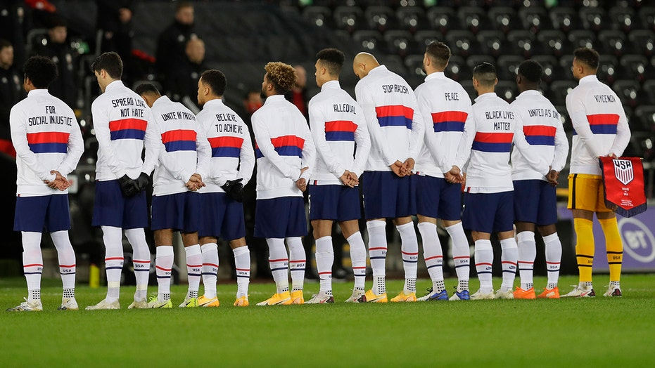 US men's soccer team wears social justice messages on warmup jackets before match vs. Wales