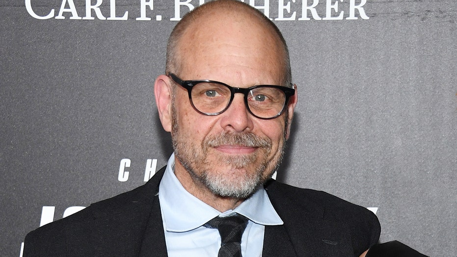Alton Brown apologizes for 'flippant' Holocaust tweet, says he wrote it because he's 'deeply frightened'